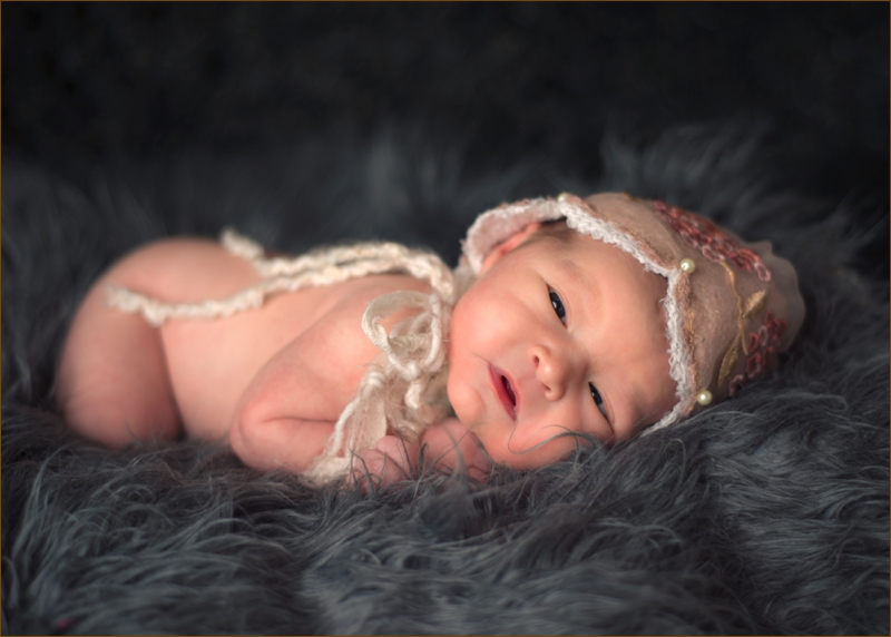 The best newborn photographer in atlanta is beverly hall.